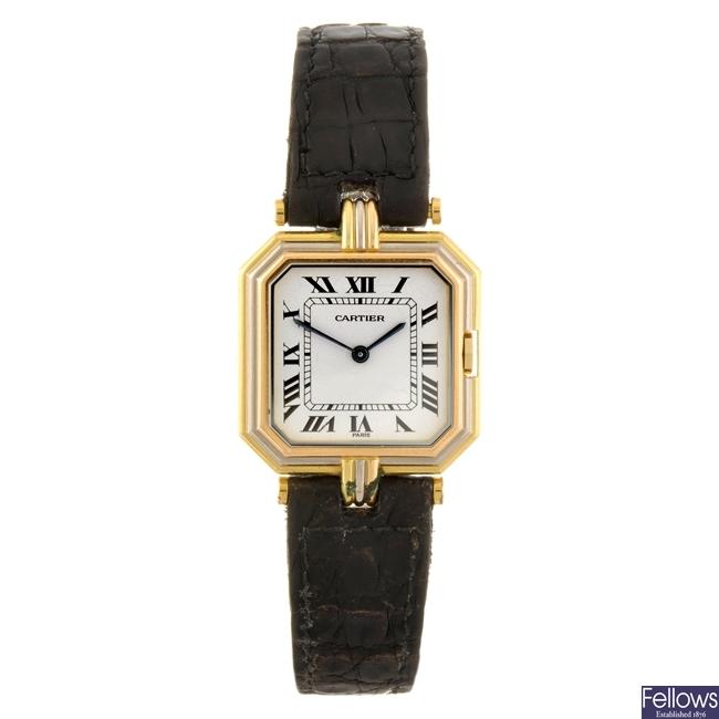 An 18k gold quartz Cartier Ceinture wrist watch.