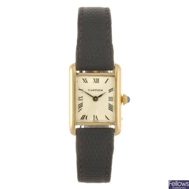 An 18k gold Cartier Tank wrist watch.