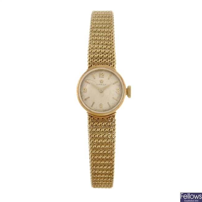 A 14k gold manual wind lady's Omega bracelet watch.