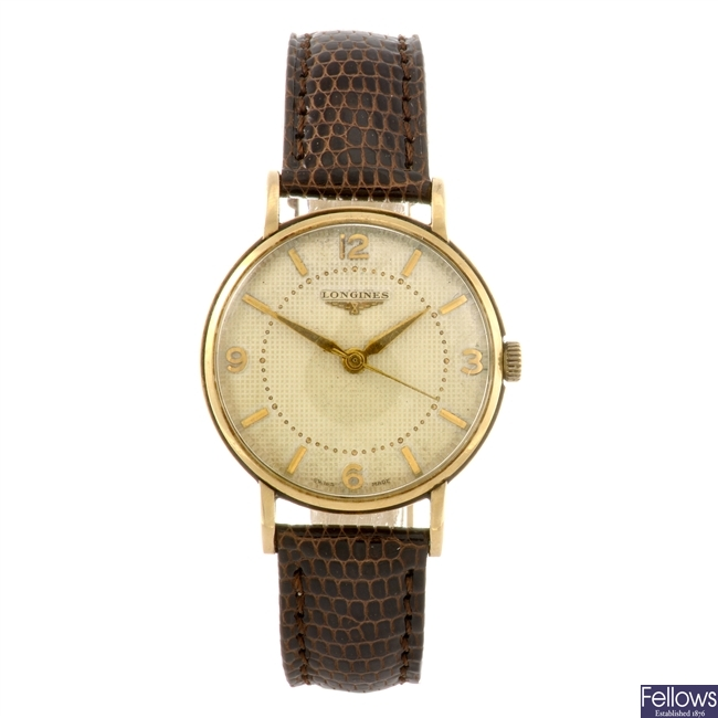 A 9ct gold manual wind gentleman's Longines wrist watch with a gold plated Rotary watch head.
