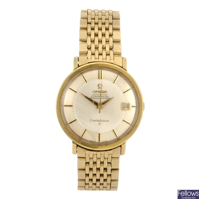 A gold plated automatic gentleman's Omega Constellation bracelet watch.
