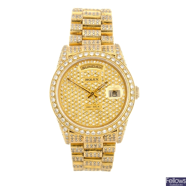 An 18k gold automatic gentleman's Rolex Day-Date bracelet watch.