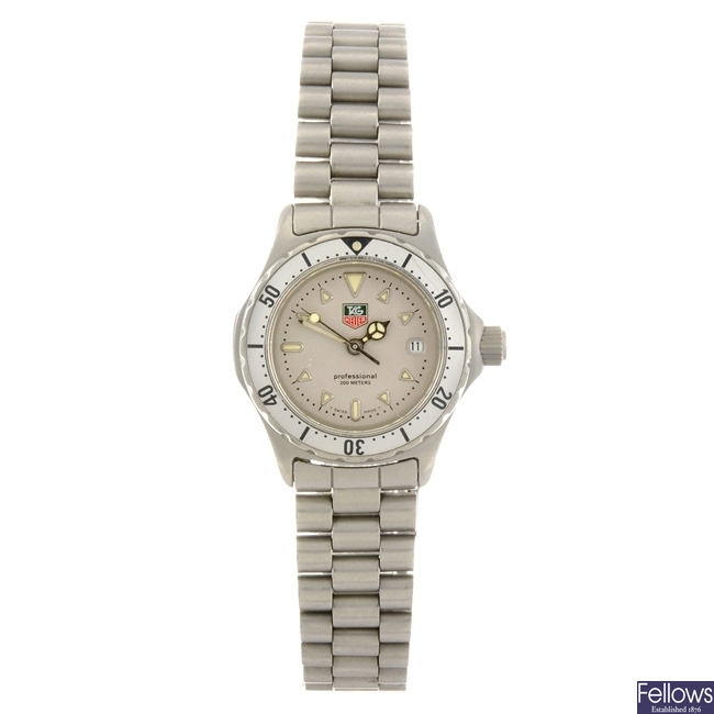 A stainless steel quartz lady's Tag Heuer 2000 Series bracelet watch.