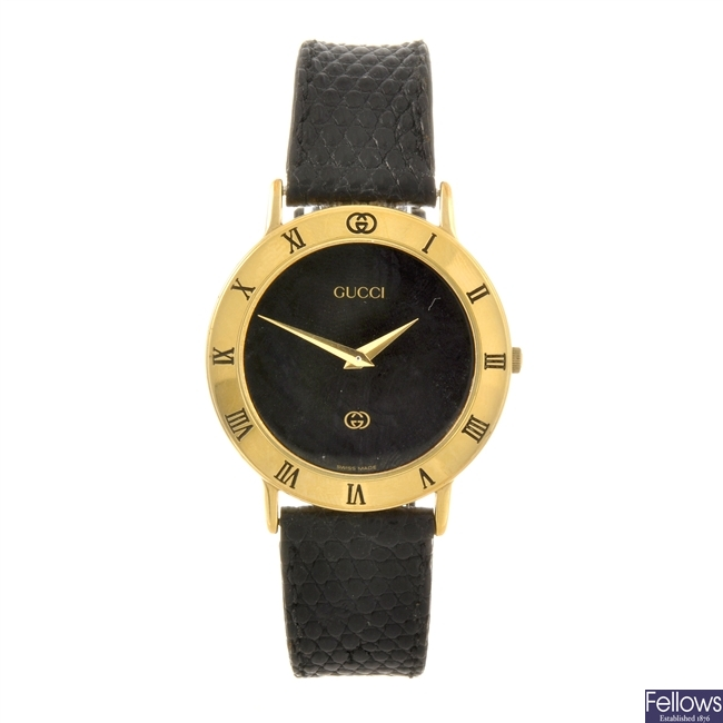 A gold plated quartz gentleman's Gucci wrist watch.