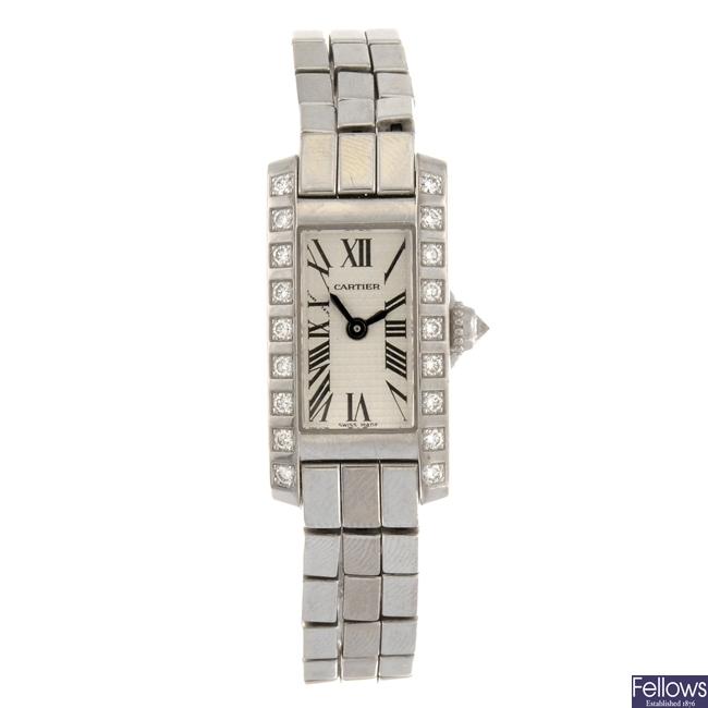 (6111) An 18k gold quartz Cartier Tank Allongee bracelet watch.