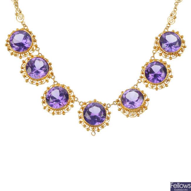 A synthetic colour-change sapphire necklace.