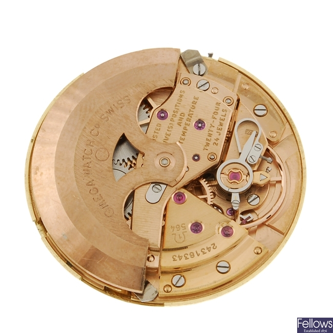 An Omega watch movement and dial.
