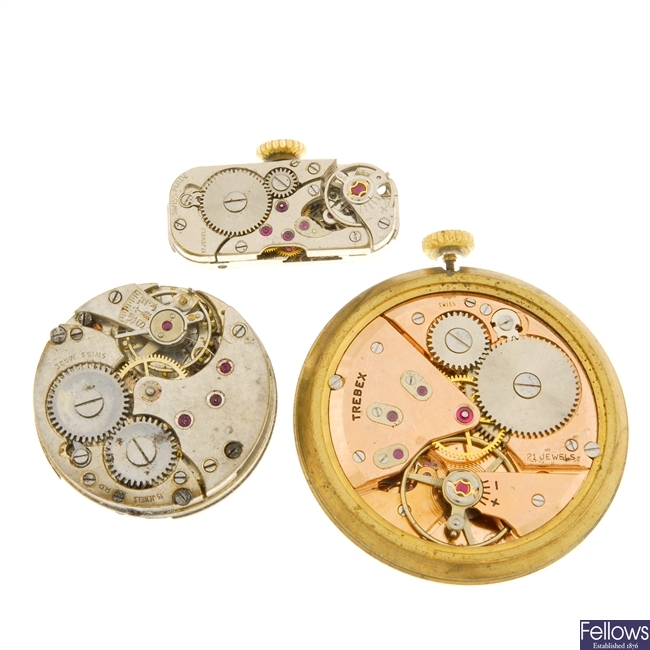 A small group of watch movements.