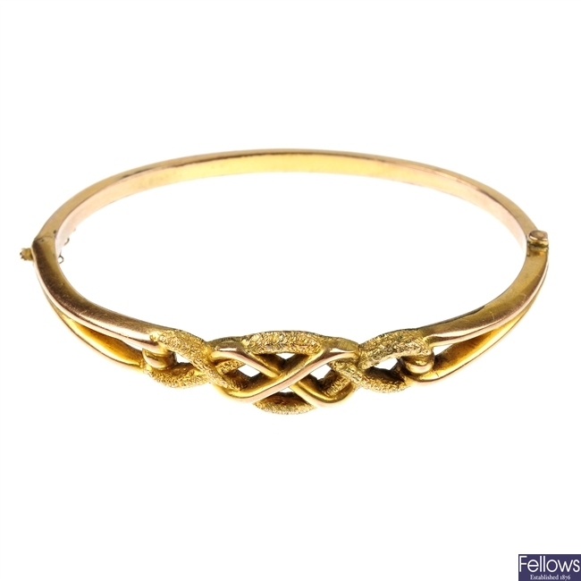 A late 19th century 9ct gold hinged bangle.