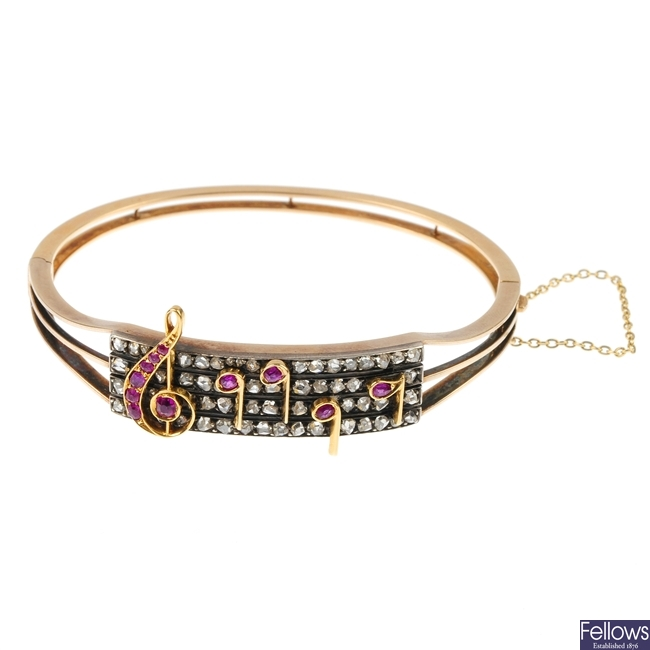 A late Victorian gold and silver ruby and diamond bangle.