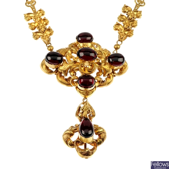A late 19th century gold garnet necklace.
