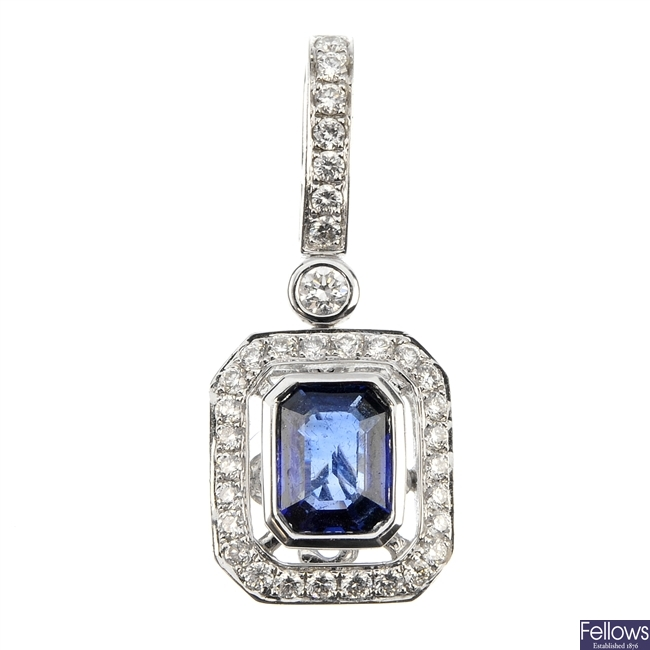 A sapphire and diamond cluster pendant.
