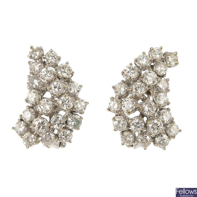 A pair of mid 20th century diamond earrings.
