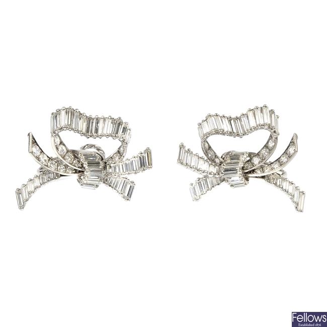 A pair of diamond bow ear clips.
