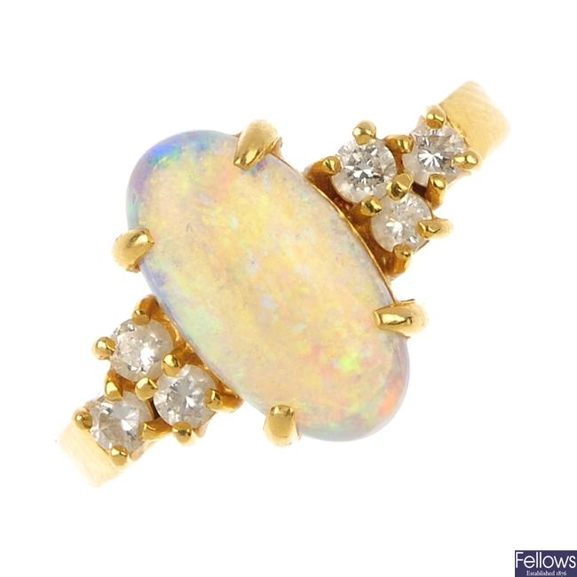 An opal and diamond dress ring.