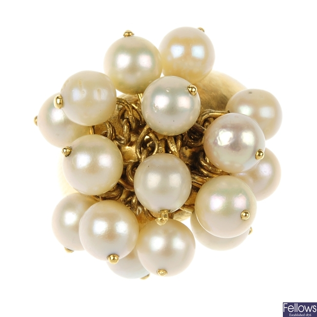 A cultured pearl cluster dress ring.