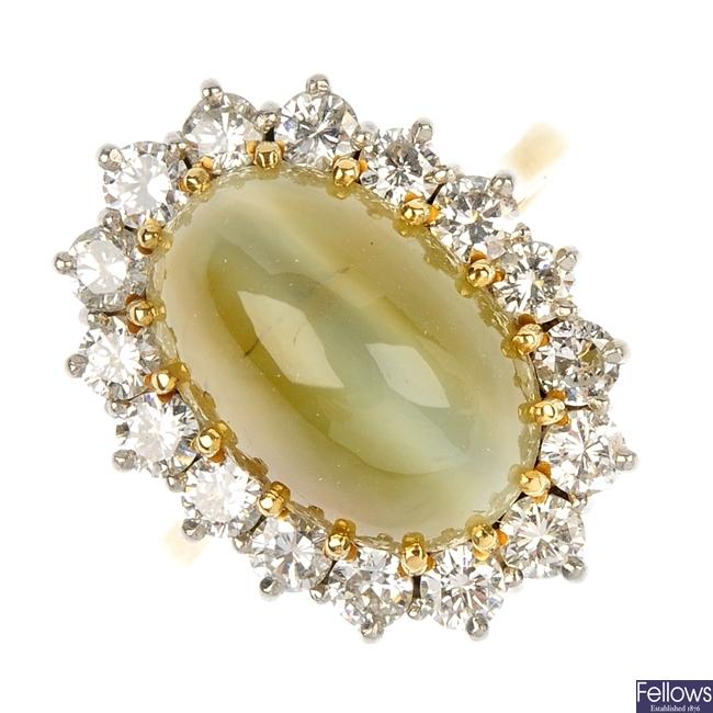 An 18ct gold cat's-eye chrysoberyl and diamond ring.