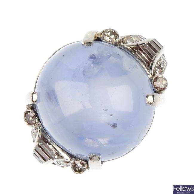 A star sapphire and diamond dress ring.