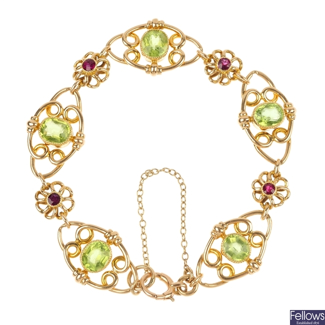 An early 20th century 15ct gold peridot and garnet bracelet.