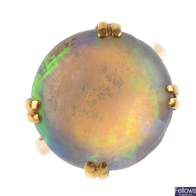 A mid 20th century gold opal single-stone ring.