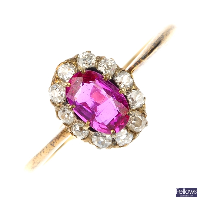 A mid 20th century gold ruby and diamond cluster ring.