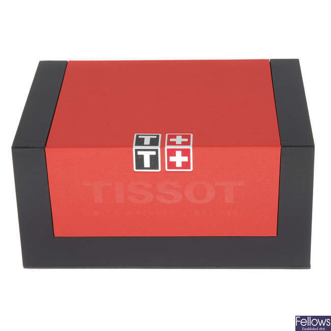 A group of complete Tissot watch boxes.