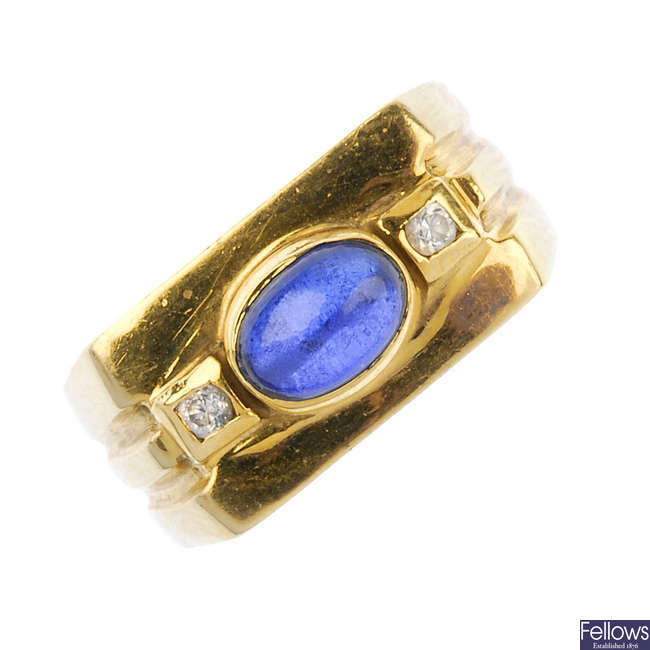 A synthetic sapphire and cubic zirconia dress ring.
