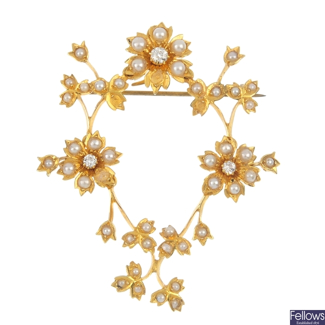 An early 20th century diamond and split pearl floral brooch.