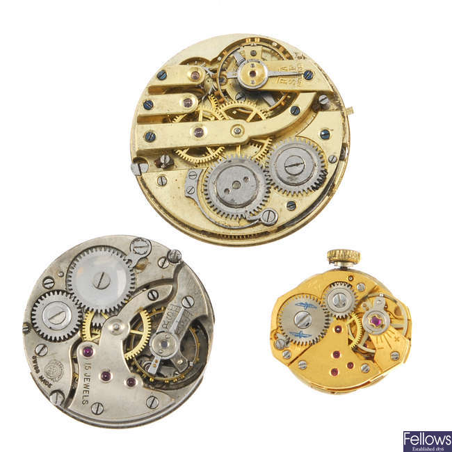 A selection of wrist watch and pocket watch movements in different styles and sizes.