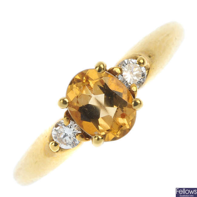 An 18ct gold topaz and diamond three-stone ring.