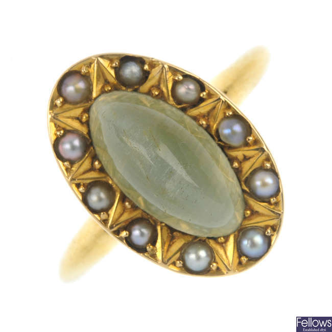 A late 19th century 18ct gold cat's-eye gem and split pearl cluster ring.