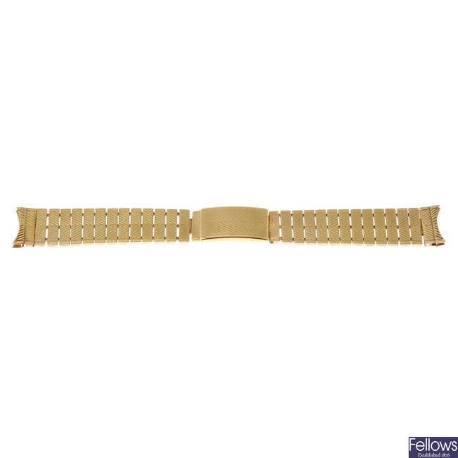 A group of five watch bracelets.