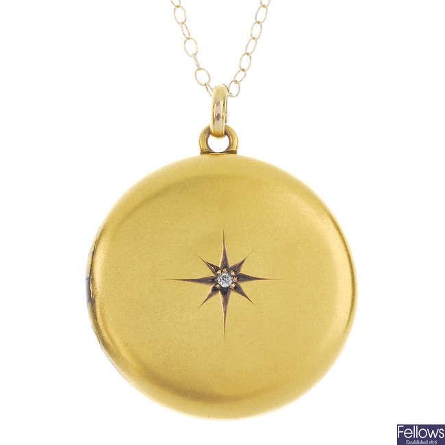 An early 20th century gold diamond locket.