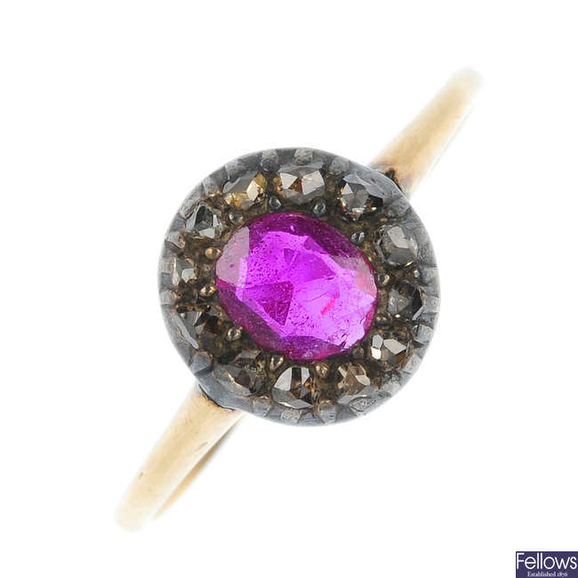 An early 20th century silver and gold synthetic ruby and diamond cluster ring.