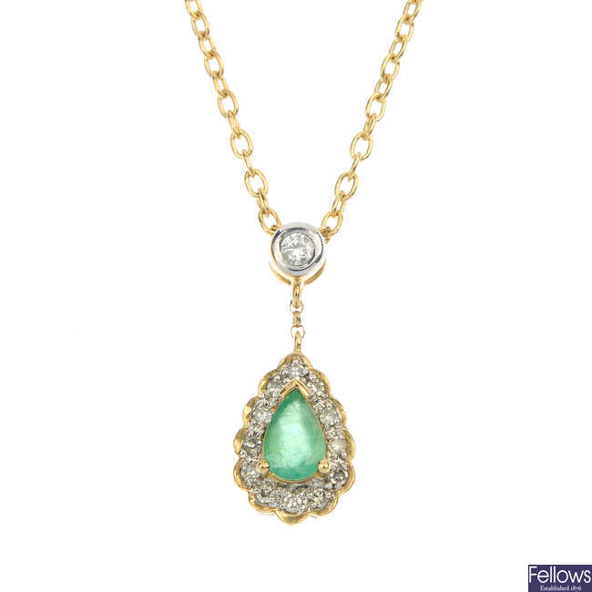 An emerald and diamond cluster pendant.
