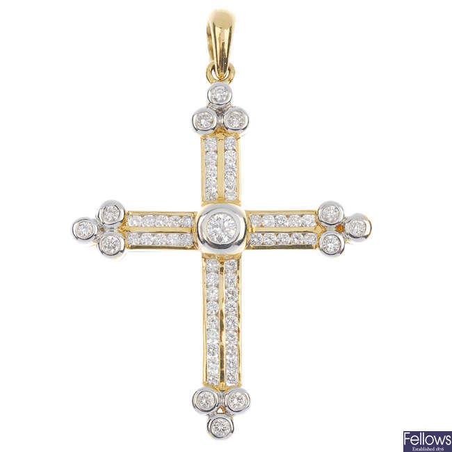 An 18ct gold diamond cross.