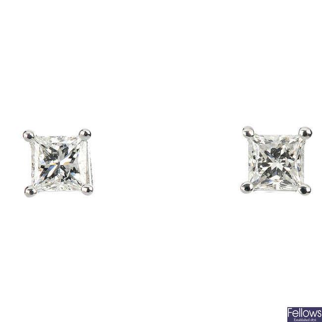 A pair of 18ct gold square-shape diamond single-stone ear studs.