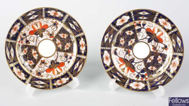 Twenty-four Royal Crown Derby plates