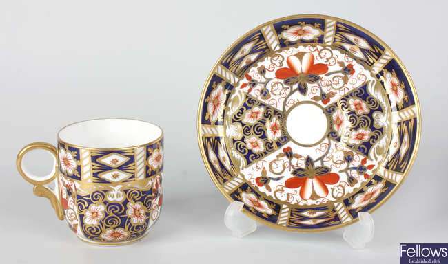 A set of twelve early 20th century Royal Crown Derby tea cups and coffee cans with saucers