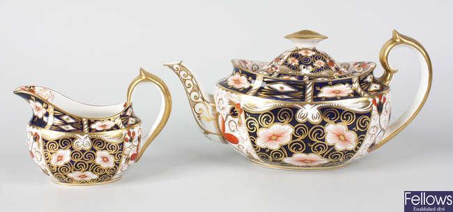 A Royal Crown Derby teapot, sucrier and milk jug, etc.