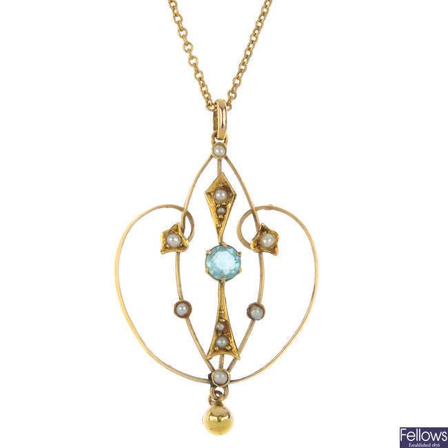 An early 20th century 9ct gold split pearl and paste pendant.