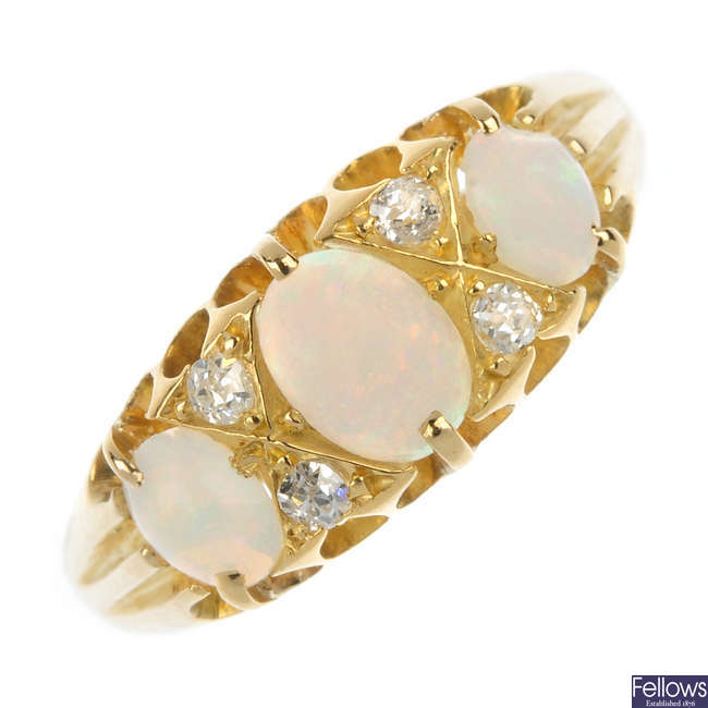 An early 20th century 18ct gold opal and diamond three-stone ring.