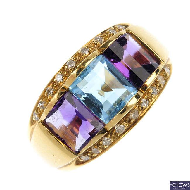 A topaz, amethyst and diamond dress ring.