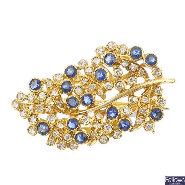 A sapphire and diamond foliate spray brooch.