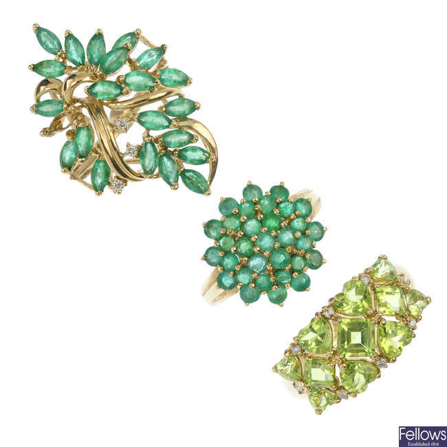 A selection of three 9ct gold emerald and peridot dress rings.