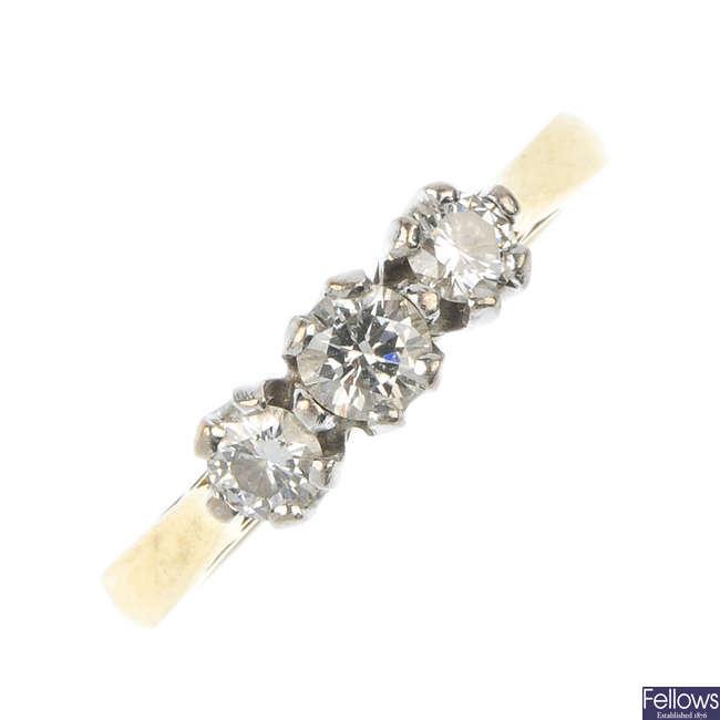 An 18ct gold diamond three-stone ring.