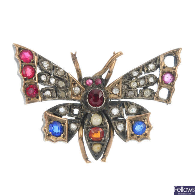 A late Victorian silver and gold diamond and gem-set butterfly brooch, circa 1880.