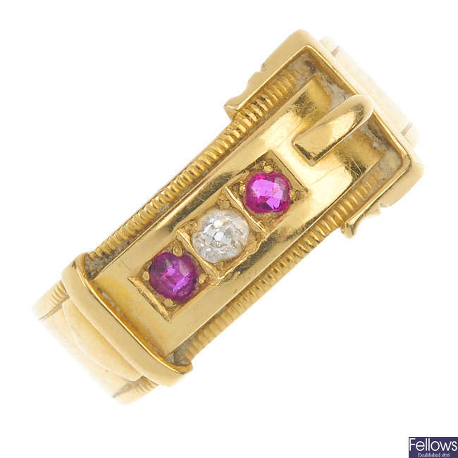 A late Victorian 18ct gold diamond and ruby buckle ring.