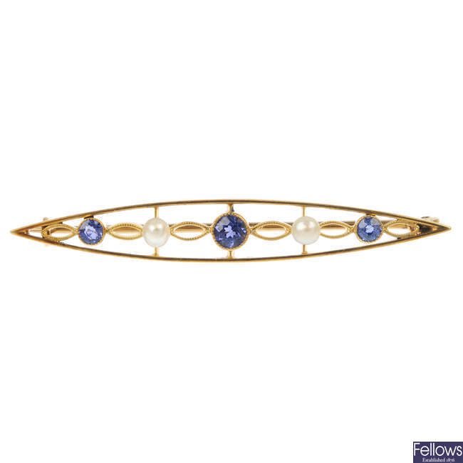 An early 20th century gold sapphire and seed pearl bar brooch.