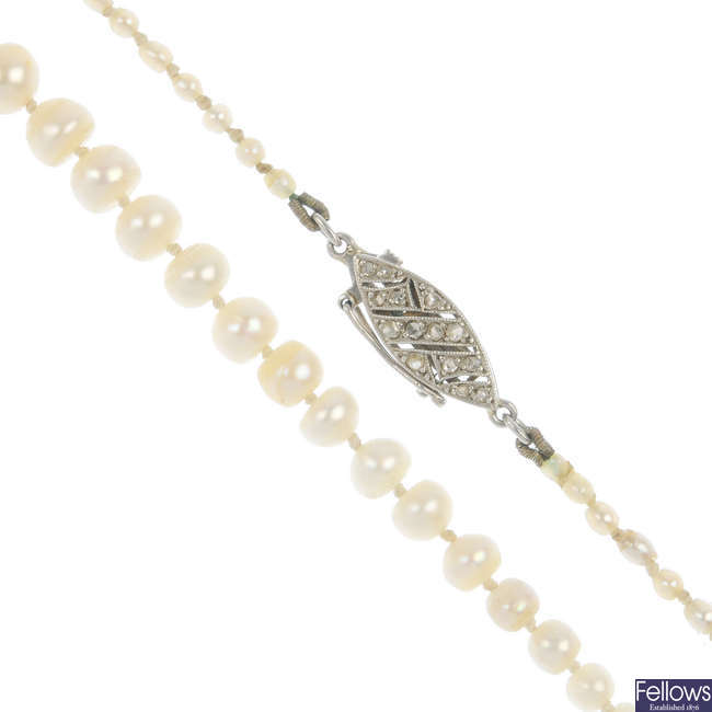 A natural pearl single-strand necklace, with diamond clasp.